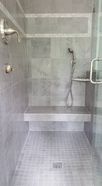Ceramic wall and floor tiles in and around a shower