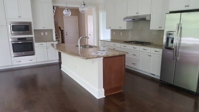A recently remodeled kitchen with wood flooring