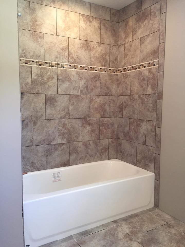 Ceramic wall and floor tiles around a bathtub