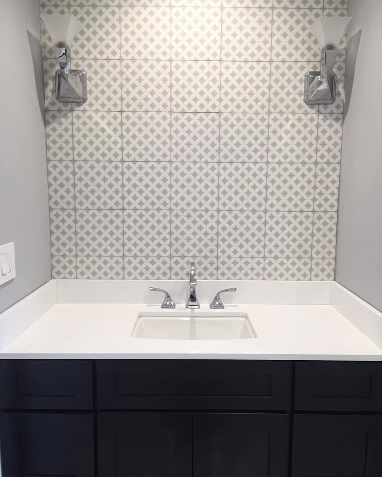 Intrinsically designed wall tiles behind a bathroom sink