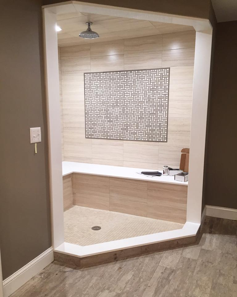 A recently remodeled sitting shower