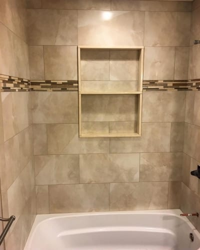 Marble wall tiles around a bath and shower combo