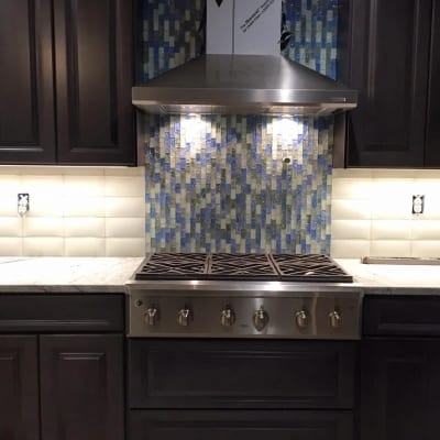Stained glass tiles behind kitchen counter