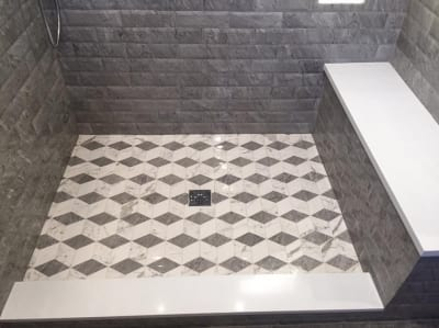 Marble floor and wall tiles in open shower