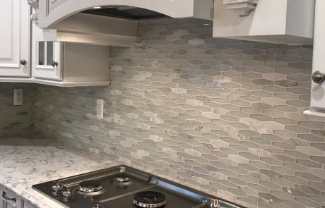 Ceramic wall pattern behind kitchen counter