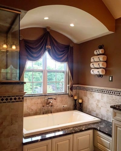Marble wall tiles accenting an inset bathtub