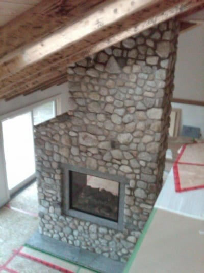 Stone tile accent around a fireplace