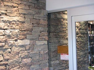 Stone tile brick accent near an automated glass door