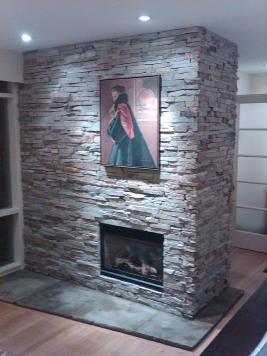 Stone brick accent around a fireplace