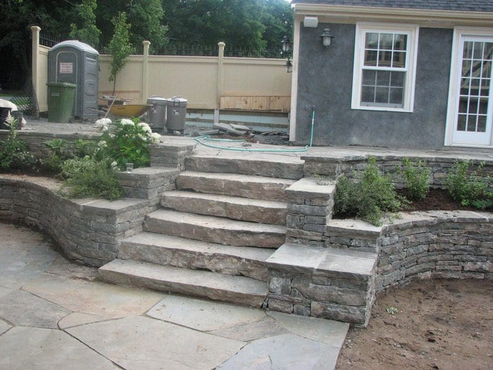 A patio made from stone tile bricks