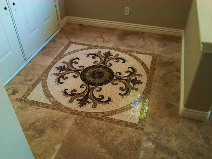Patterned marble floor tiles in entryway