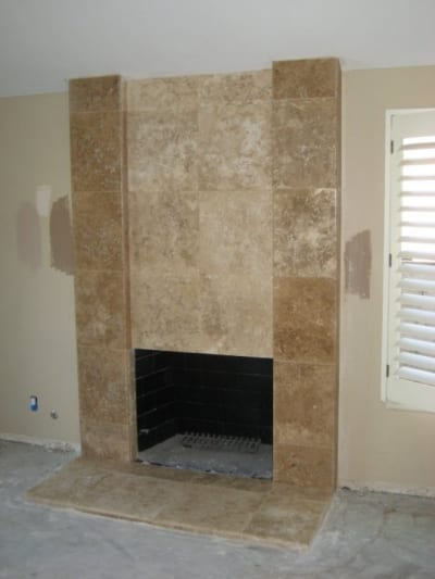 Marble tiles around a fireplace