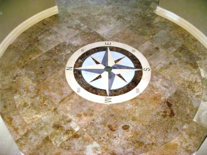 Marble floor tiles with embedded compass made from marble tiles