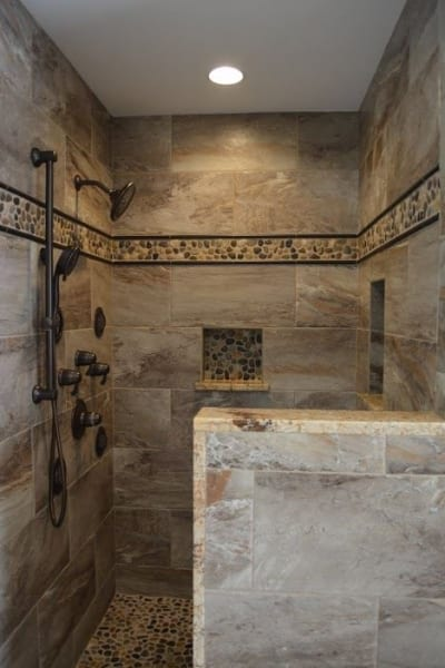 Marble wall and floor tiles accenting a large standing shower
