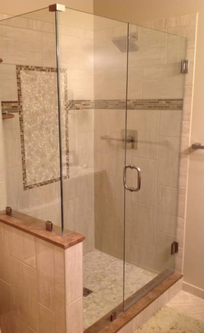 Ceramic wall and floor tiles accenting a large standing shower