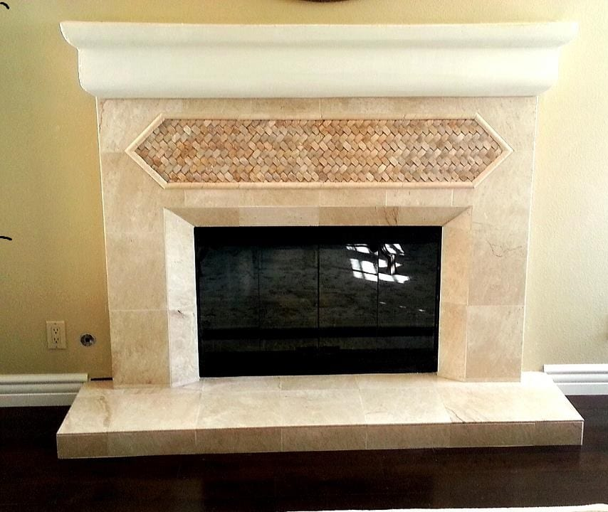 Granite tiling around a fireplace