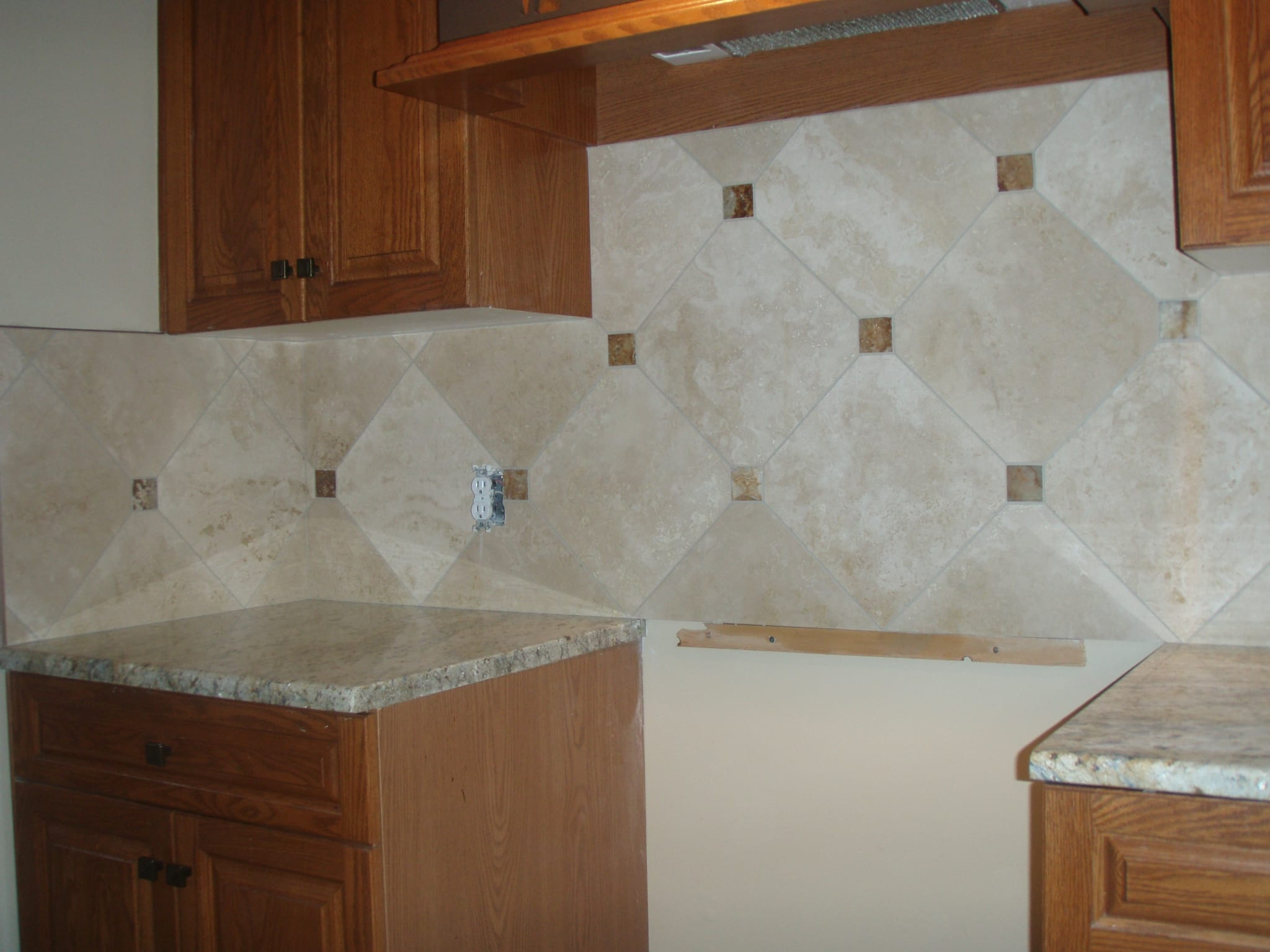 Marble wall tiles behind kitchen counter
