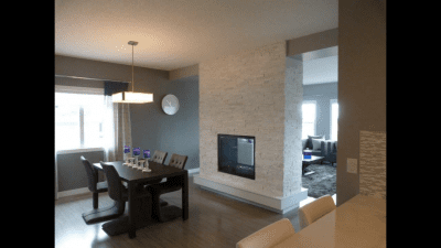 White stone brick accent around a divider-style fireplace