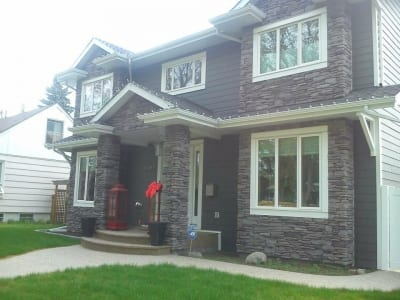 Front exterior of a house with stone tile siding