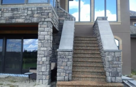 A custom-built stairway leading up to the second floor entrance of a house