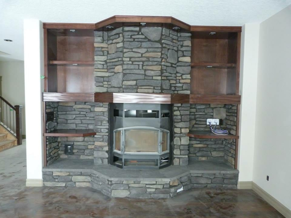 Stone and concrete accent around a fireplace