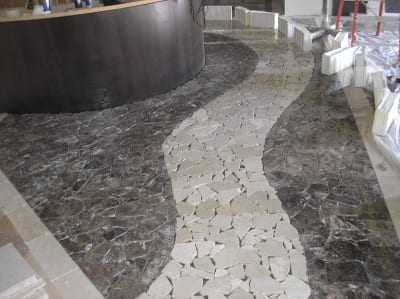 Stone tile flooring arranged to resemble a path