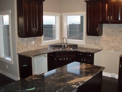 Ceramic wall tiles behind kitchen counter