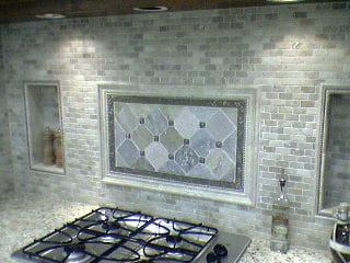 Ceramic and stained glass wall tiles behind kitchen counter